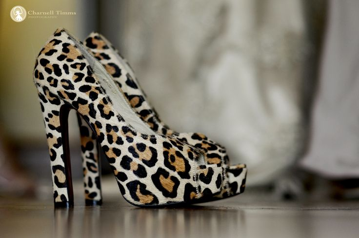 Bride Neisha wearing a pair of African leopard print wedding shoes at Spier Wine Estate, South Africa