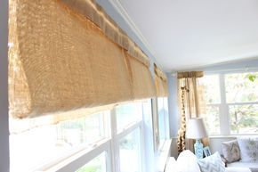 I turned burlap table runners leftover from our wedding reception into 4 beautiful Roman shades for our well-used sunroom! Should have done this 2 years ago!