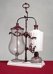 An antique balance siphon coffee maker
