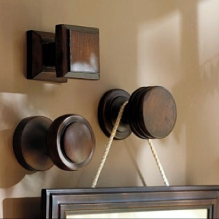 Old drawer pulls to hang pictures from