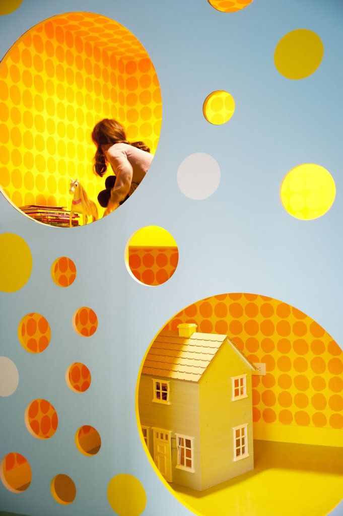 what a cool idea. climbing wall, playhouse and playroom all in one.