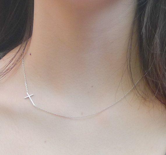 silver sideways cross necklace in silver $14.00 @Emily Schoenfeld Schoenfeld Schoenfeld Schoenfeld Prais