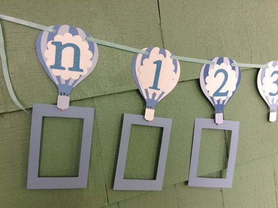 Details: This listing is for 1 Newborn to 1 year banner hot air balloon photo banner customizable to include color and style of your choice. Each card is a hot air balloon image approximately 5.5 inches. This banner is approximately 5 feet long. Each card on the banner fits a 4x6 photo. The numbers are approximately 2 .5 inches and each card includes a clothespin so you can easily attach each picture.  **If you choose the option, Add Frames, you will be provided with 13 paper frames for 4x6…