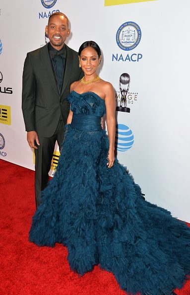 Will Smith with wife Jada Pinkett Smith in a teal gown at the 47th NAACP Image Awards at Pasadena Civic Auditorium in Pasadena, California.