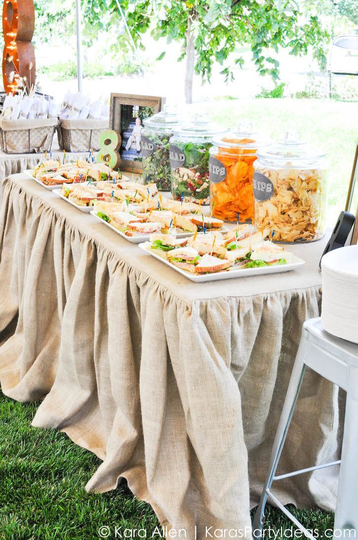 Love the food in jars! Food table at a Chalk + Chalkboard and Burlap themed baptism luncheon party via Kara Allen | Kara's Party Ideas | KarasPartyIdeas.com #baptism #ldsbaptism #karaspartyideas