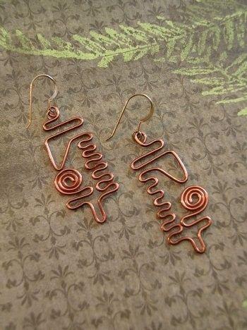 art copper earrings. Uy, me encantaron, y yo podría hacer mis propias versiones.