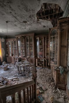 I love these photos of old abandoned buildings! Who could leave all these books, not to mention the beautiful cabinetry!  save the books!