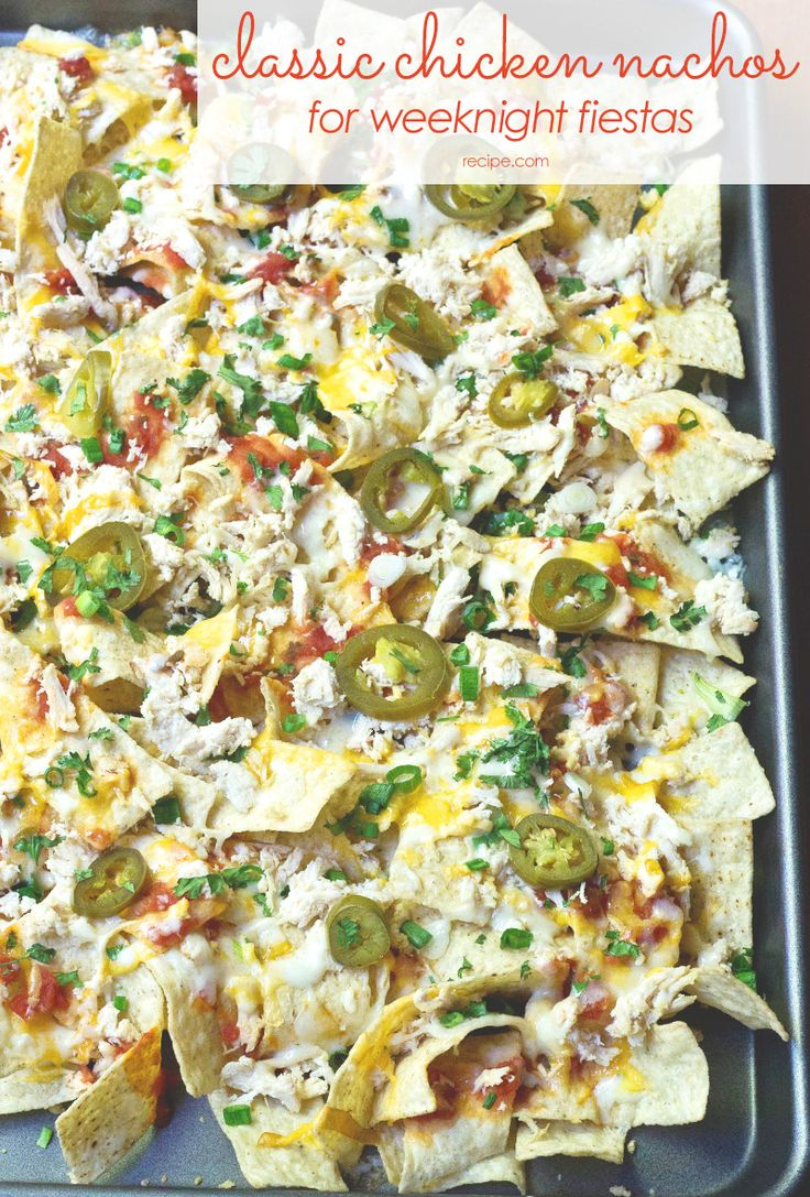 These classic chicken nachos are so good—and SO EASY—you'll want to make them a weekly tradition. #nachos #chicken