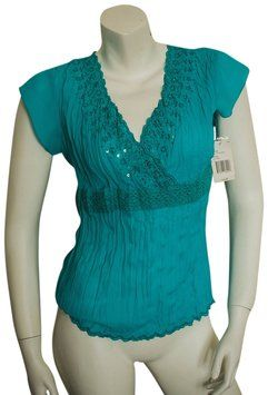 Luciano Dante Pretty #Pleats #boho #crepe #drape #blouse with #sequins and #crochet #lace #NWT. The #top has an #embroidered #flower trim w/sequins and #beads. It is a deep #vneck mock #wrap/ #ballet style top. #scalloped #embroidery. The shirt is 100% #polyester.  #drapeblouse #drapefront #wrapshirt #wraptop #bohemian #hippy #preppy #formal #datenight #date #hippie #teal #aqua #summer #spring #fall #business #businesscasual #workattire #knit #beaded #deepvneck #turquoise #pleated #nightout