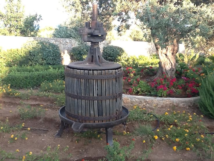 Old wooden grape presser, which belongs to the Harlaftis winery, Greece.