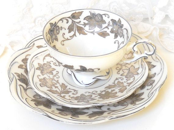 Vintage floral tea cup trio set with a beautiful gold decoration on off white porcelain. Made by PMR, Bavaria, Germany, between 1949 and 1979,