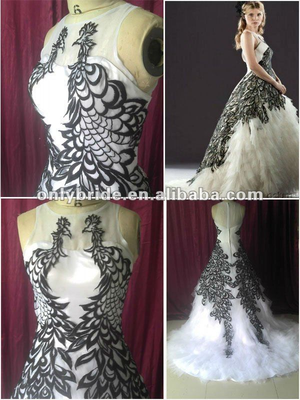 White Peacock Wedding Dress - this looks exactly like newly wed weasley dress from hp!
