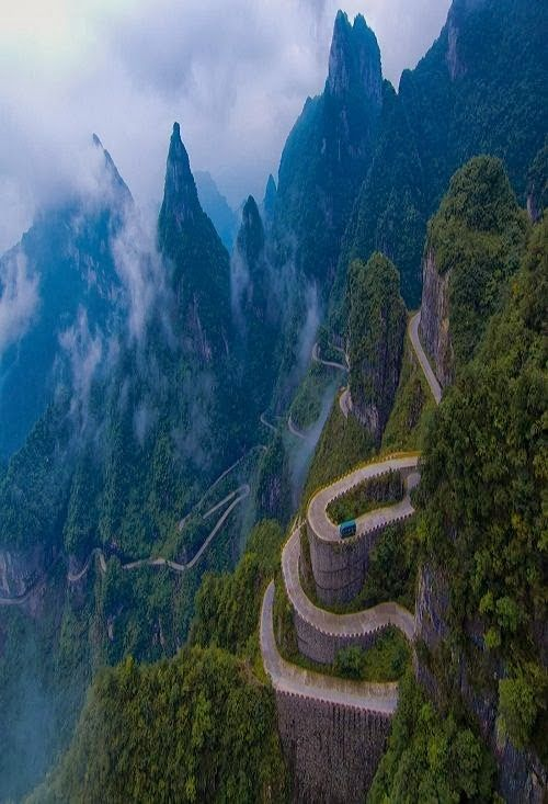 Could you imagine driving this road if it was snow-covered and slippery? YIKES!  Switchback Highway, Tianmen Mountain, China