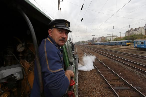 A train engineer looks out of a historic steam locomotive as it pulls a Tehran-bound train into Nyugati Terminus in Budapest, October 15, 2014. REUTERS/Laszlo Balogh visit http://www.budpocketguide.com #Iran #Persia #Tehran #Budapest #TravelToIran #MyIran #Travel2Budapest #MyBudapest