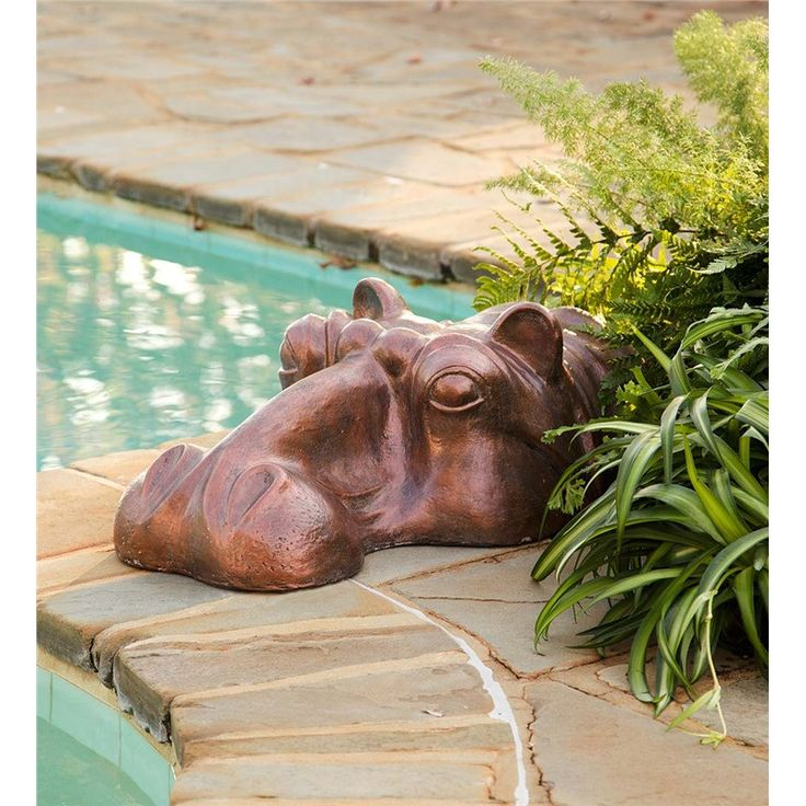 When guests see this Hippo Head Garden Sculpture emerging from your garden or poolside, they're sure to do a double take. Remarkably detailed...and impressively huge...this garden sculpture was create