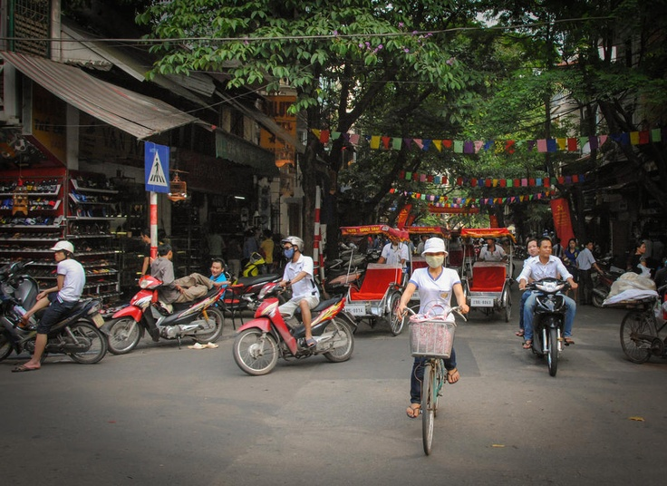 Photo of the Day - The #Streets of #Hanoi - #Hanoi, #Vietnam - #Hanoi has some of the most interesting #streets of any city in the world. Cars are replaced with bicycles, motorbikes and other creative people movers. The sides are lined with shops full of goods and the sidewalks are filled with people eating on little plastic stools or even getting their haircut right in the street. Photo from #absolutevisit at www.absolutevisit.com - all images Creative Commons Noncommercial