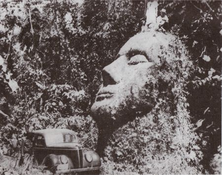 """A stone head that was found """"somewhere in the Guatemalan jungle"""" and, soon after its discovery, disappeared. The photo above was taken in the 1950s by the man who owned the land the head was located on, but after he died, the mysterious structure faded back into obscurity. While the head is theorized to potentially be an anomaly of the Olmec stone heads (it does not match their aesthetic), some think it could possibly be a remnant of a yet undiscovered culture."""