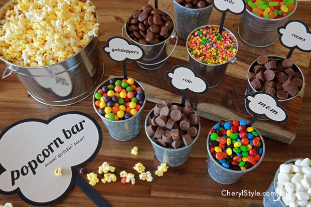 Unique containers and free printable labels for an array of scrumptious candy and savory toppings make our DIY popcorn bar a real crowd-pleaser!