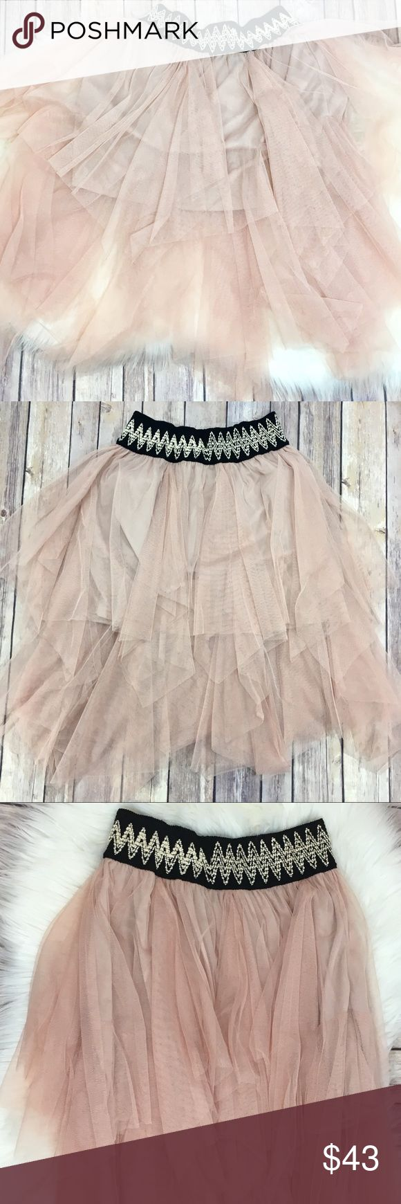 """Hommage Tulle Blush Pink Ballerina Skirt Sz Small Tulle SATC Blush Pink Ballerina Skirt Sz Small EUC  Carrie Bradshaw called & she wants her skirt back.  I'm so sad this skirt doesn't fit me! Layers of millennial pink tulle over a built in slip, and a knit elasticized waist band make this  skirt a Sex and the City dream skirt dupe.    Waistband measures approximately 10.75"""" lying flat & unstretched.  It can stretch to approximately 14"""". Slip is approximately 14"""" long, and there are various…"""