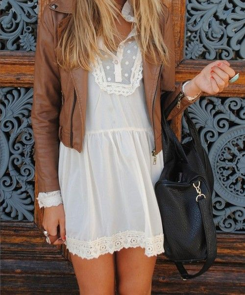 white lace dress with tan leather jacket.