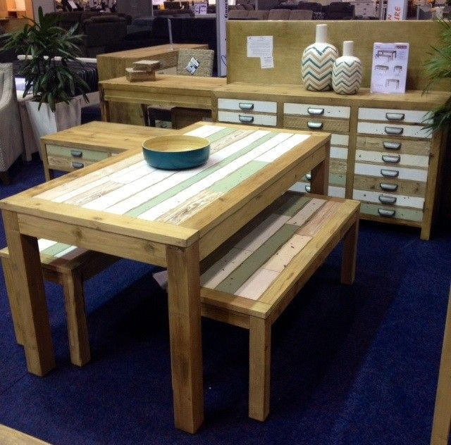 Light colourful recycled timber dining table and bench seats.