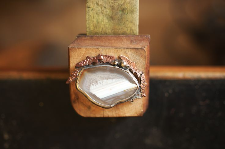 """In Winnipeg when the river breaks up, we know that it's spring."" - brooch in copper and sterling silver with agate by Diana Pops"