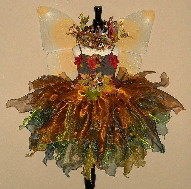 Love the skirt.....looking like leaf edges....hate the plastic fake junk tho....go with leather leaves