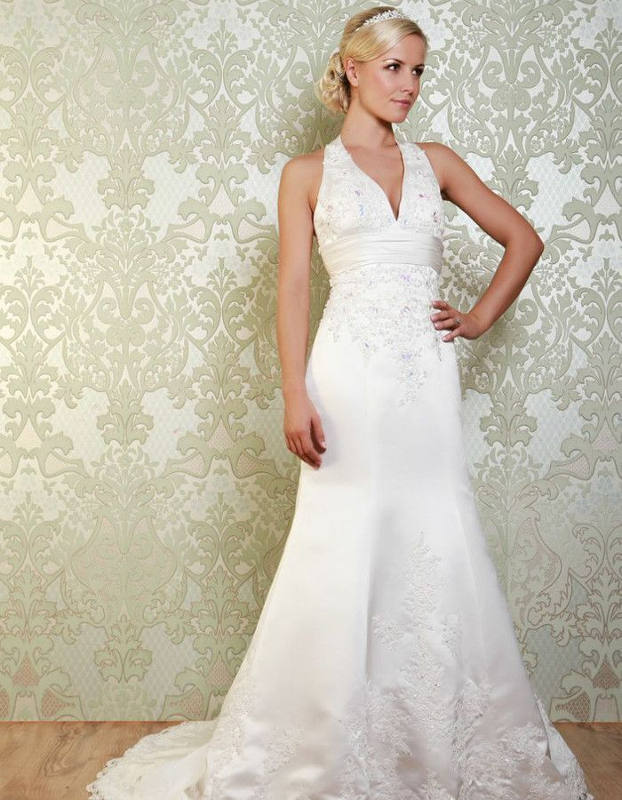 STANWYCK This beautifully embellished gown features a halterneck and intricate beading across the bodice and the lower half of the fishtail skirt. https://www.wed2b.co.uk/vintage-wedding-dresses/viva-bride-stanwyck.php