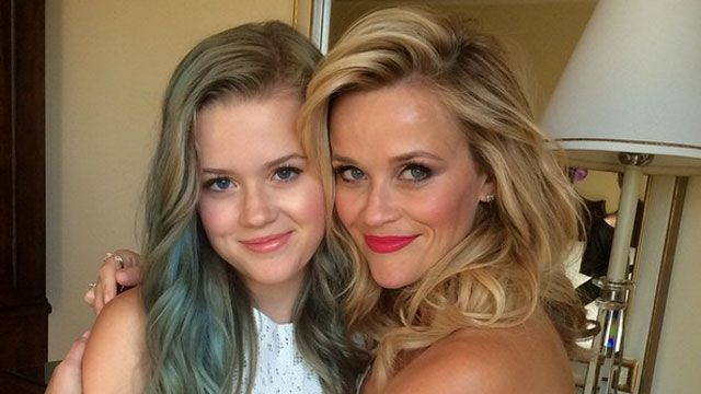 """The apple certainly doesn't fall from the tree in Reese Witherspoon's family! The 39-year-old actress shared an Instagram pic on Thursday of her and her lookalike daughter, 15-year-old Ava Phillippe. The mother-daughter duo looked picture perfect as Reese hugs the blue-haired teen. PHOTOS: Celebrity Lookalikes """"Me and my girl,"""" Reese wrote. """"Ready for #HotPursuit premiere! @avaphillippe."""" NEWS: Ryan Phillippe and Reese Witherspoon Explained Cruel Intentions To Their Kids Ava, whosefather is…"""