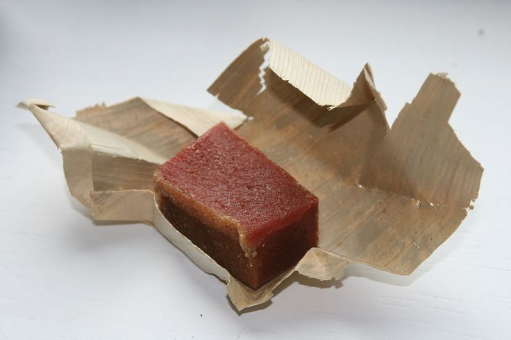 """Guava jelly (Spanish: bocadillo (de guayaba), """"(guava) snack""""), is a, Colombian confectionery made with guava pulp and panela, which is consumed abundantly throughout Colombia, one of the largest guava producers in the world. The town of Vélez, Santander Department, is a major centre of production for the sweet and gives it the alternative name """"bocadillo Veleño""""."""