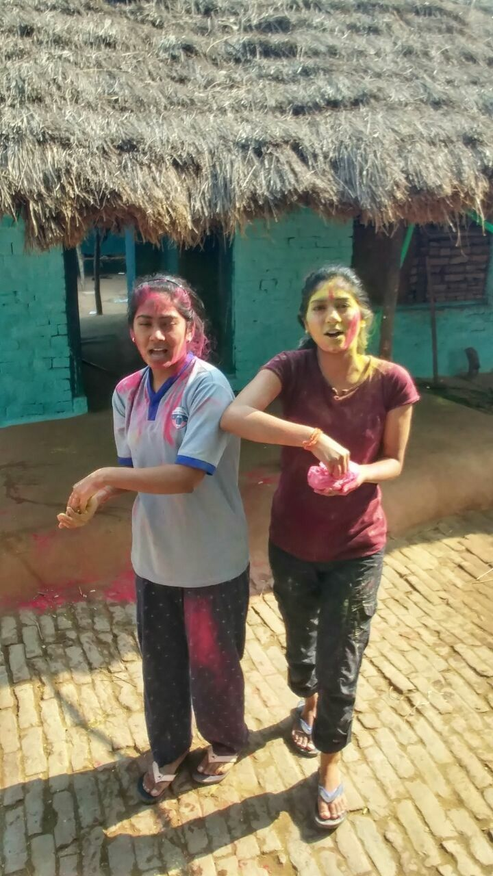 Young girls of urban India celebrating Holi (festival of colors) in rural India