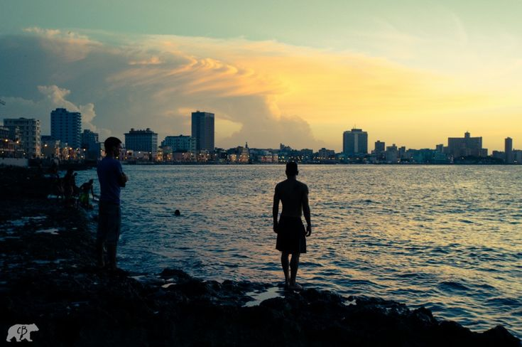 Malecón Throughout the day the Malecón was always a focal point of social life, as residents jumped from the rocks into the ocean.//Portraits from the streets of Havana, Cuba - Matador Network