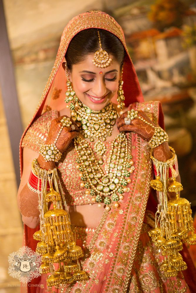 Real Indian Wedding - Sukriti and Gaurav | Polki and Emerald Necklace and Choker with Gold Kaleere, Pink Lehenga with Veil, Dull Gold and Bronze Embroidery | WedMeGood  #wedmegood #indianwedding #indianbride #kaleere #gold #polki #indianjewelry #lehenga
