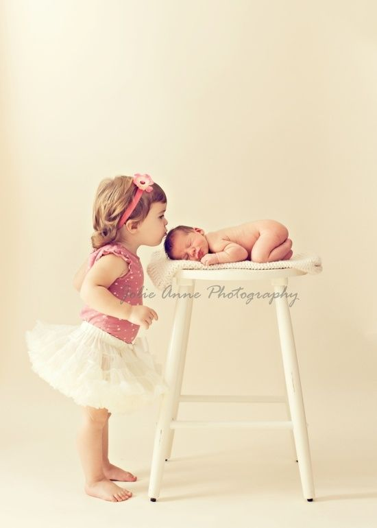 newborn big sister pose