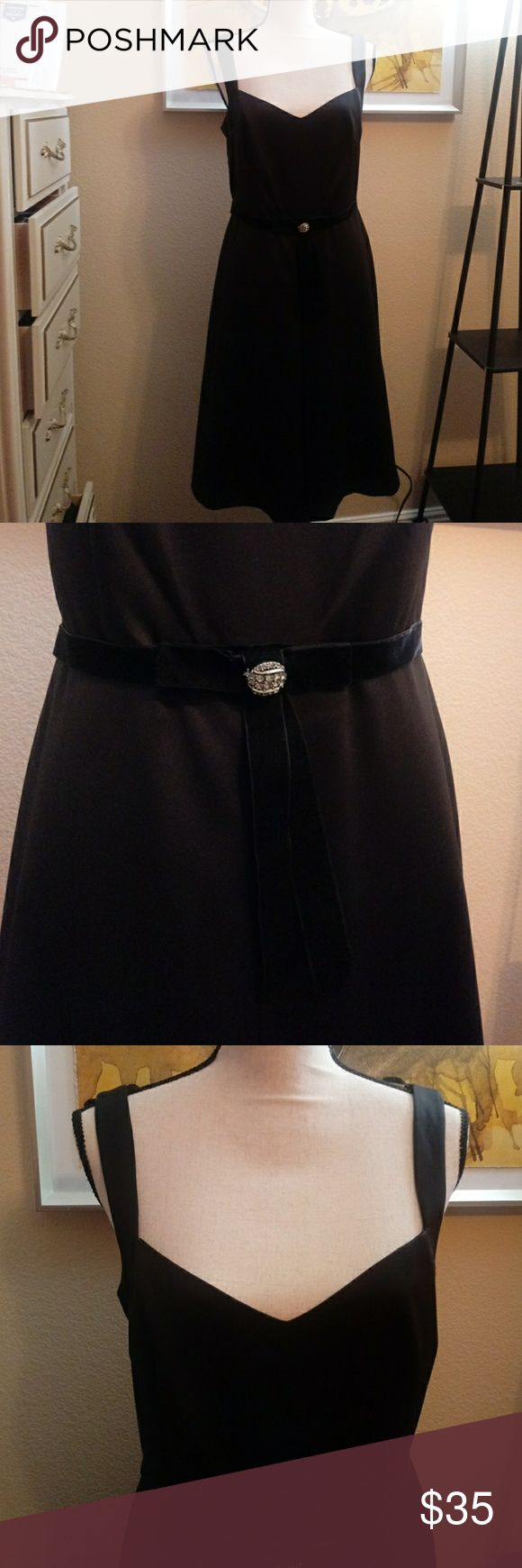 """EUC Laundry Shelli Segal Black Cocktail Dress 6 This gorgeous black size 6 Laundry Shelli Segal Dress is a poly blend but reads satiny. Features beautiful built in velvety belt at waist with bow and rhinestone embellished pin at waist. Also has really cool snaps at straps to keep bra hidden. In very good condition, only worn 2-3 times. No flaws i can find. Has """"A line"""" shape which gives great swingy shape.  Bust-16.5"""" Waist-15"""" Overall length-38.5 (from shoulder to hem)  Bundle & Save. Open…"""