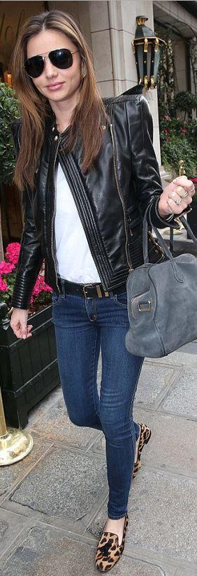 Who made Miranda Kerr's gold aviator sunglasses, leopard tassle loafers, belt, gray suede handbag, and black leather jacket?