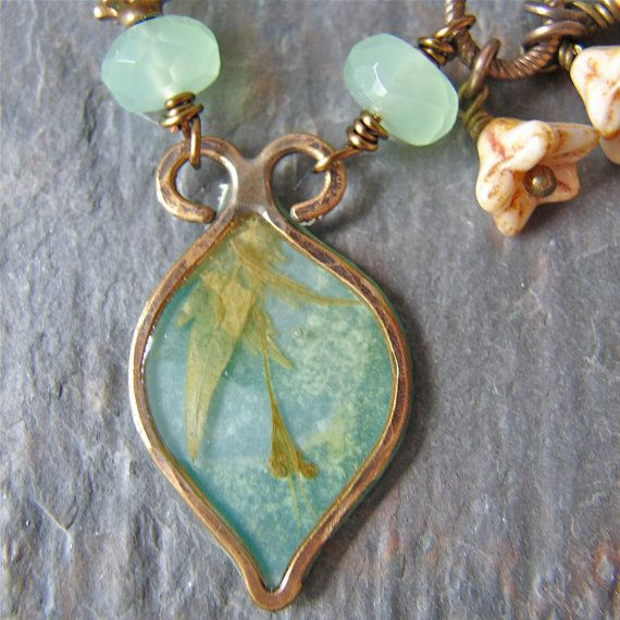 One of a kind pendant is handmade by Shannon LeVart - Missficklemedia using layers of paper, ephemera and resin.  Hand wire wrapped bell flowers dangle between wire wrapped faceted glass beads.  Vintaj Natural Brass chain.