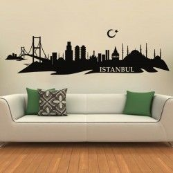 """Istanbul Skyline Wall Decal  Imagine escaping to an exotic new locale with our beautiful Istanbul Skyline Wall Decal. This design illustrates the majestic landscape of the ancient Turkish city, with both classic and modern structures. Complete with the symbol of the Turkish flag and a cutout serif-font label reading """"Istanbul"""", this decal will add a rich backdrop to any room.  S :-- 24"""" X 7"""" M :-- 48"""" X 13"""" L :-- 87"""" X 24"""""""