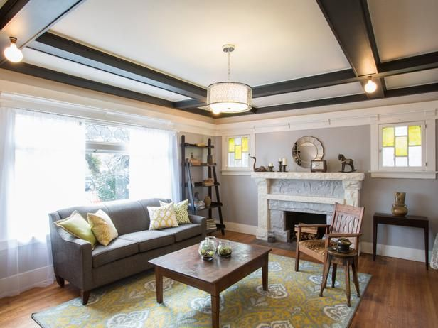 As seen on HGTV's Brother Vs Brother.  Episode 3: #TeamDrew Living Room: Gray Traditional, Stones Fireplaces, Gray Area Rugs, Rustic Wooden, Traditional Sofas, Hgtv S Brother, Gray Living Rooms, Wooden Shelves, Yellow Accent