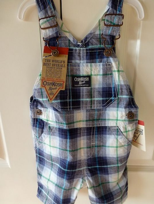 Cute OshKosh overalls in blue, white and green checks.  Adjustable straps, 3 pockets at front and two at back.  Two snaps at bottom for ease of changing.  Size 1  Machine washable, 100% cotton.