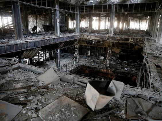 Once a treasure trove of Unesco-registered rare books, the central library of the University of Mosul is now a blackened husk, full of ash.  Less than a year after it captured the city in the summer of 2014, Isis all-but destroyed the building and burned its books. University professors and officials were forced to flee – but one man, Mosul's librarian-in-exile, is still fighting for its survival.