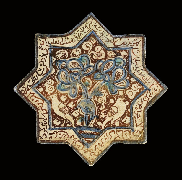 A KASHAN LUSTRE-DECORATED TILE, CENTRAL IRAN, 13TH CENTURY   Of eight pointed stellar form, decorated in lustre over a tin glaze with inglaze cobalt blue and turquoise, with a central spray of large tri-lobed leaves with a pond below and pair of birds either side, a ground of scrolling cloudsenclosed by a border of cursivie calligraphy - 8in (20.2cm) diameter