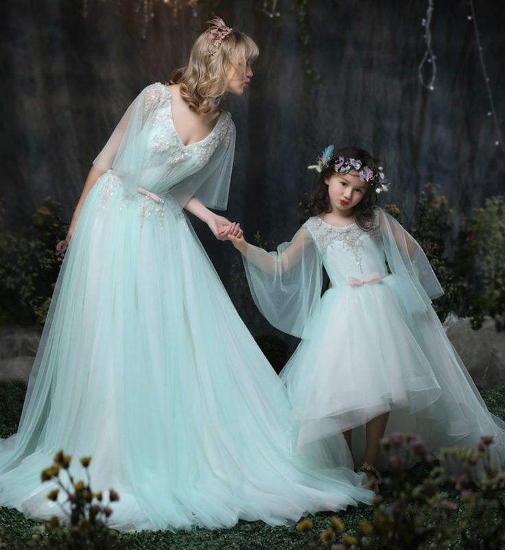 Mommy & Me Dress -  These matching mother daughter dresses are perfect for photo shoot, wedding, birthday or any occasion. Daughter dress product description: Color: Light mint blue (teal) & White. Length: Midi. Style: Sheer long sleeve, Pink bow back, button, high low with sheer tail. Embellishment: Flower beads. Material: Organza, cotton, tulle mesh, soft polyester fiber - Mother dress product description: Color: Light mint blue (teal) & White. Length: Floor length. Style: Sheer short…