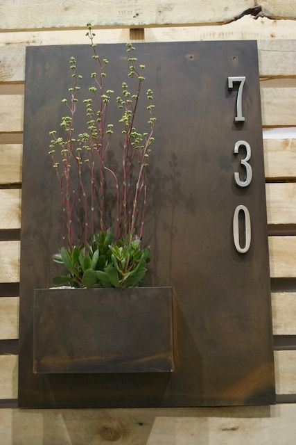 First impression count! Constructed from steel it's a planter box and street number in one – a real curb stopper!