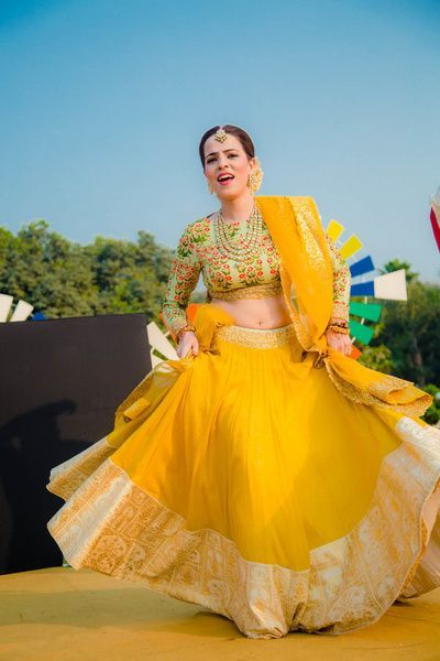 Light Lehengas - Bride in a Yellow Light Lehenga with a White Border and a Green and Orange