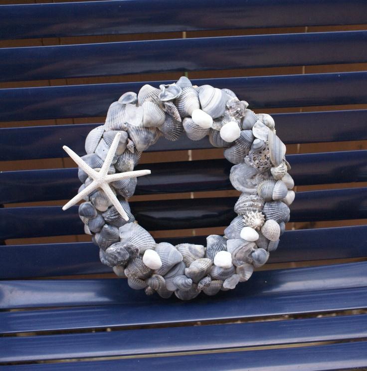 Blue seashell wreath, sea shell decor, spring wreath, beach wreath, nautical. $59.99, via Etsy.
