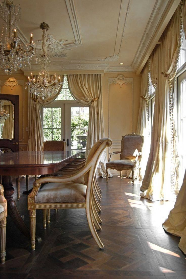 Elegant Dinning Room With High Pulled Back Drapes And Chandeliers I Love The Windows