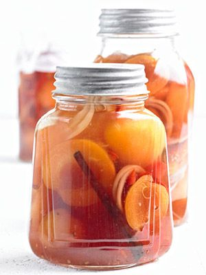 Sweet-Hot Pickled Peaches | The surprising heat of fresh ginger highlights the flavor of pickled peaches. Serve it alongside barbecued pork or chicken or chopped up and piled high on a burger. Save the juices to drizzle over pound cake or grain salads.