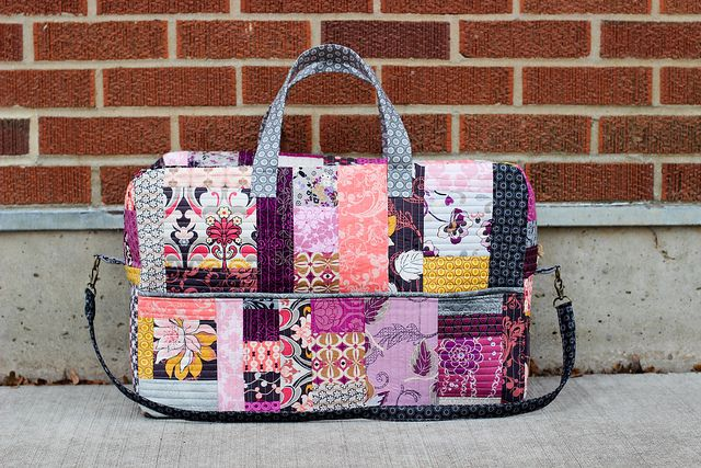 @Jeni Baker at In Color Order made a drop dead gorgeous bag using a @Bari Ackerman pattern, @Pat Bravo 's Rock n Romance fabrics and #Aurifil 50 wt, #2600. Loving this bag!!!!  To read more visit http://www.incolororder.com/2012/12/patchwork-duffle-bag.html