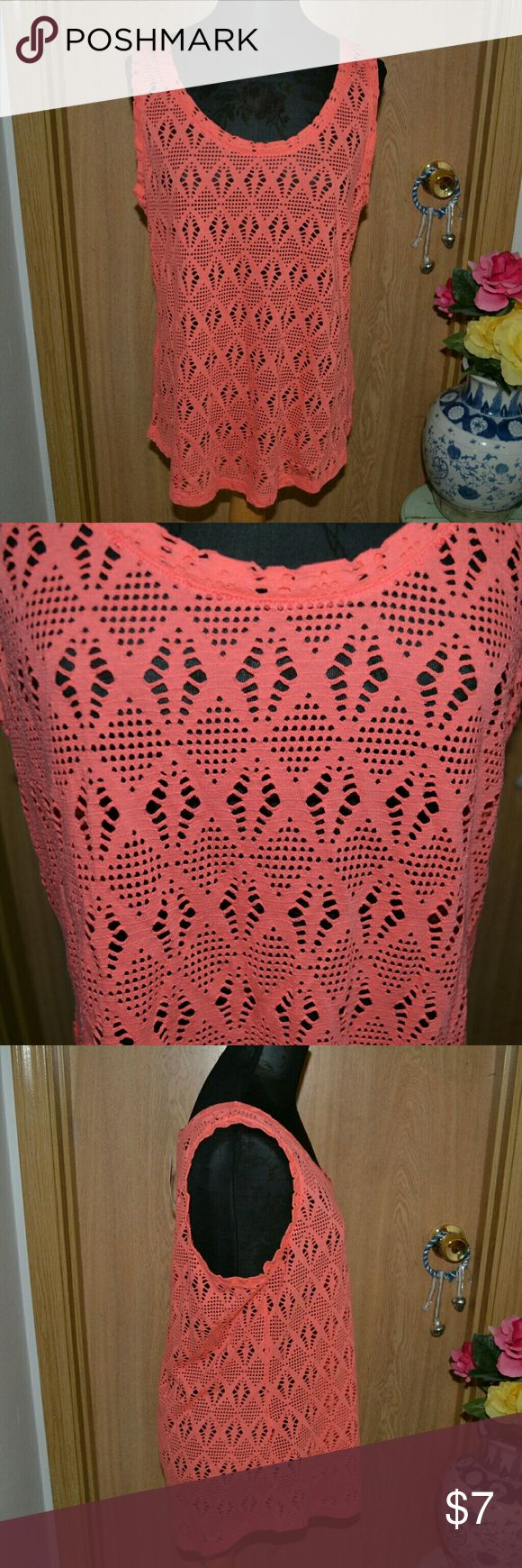 NWT! Old navy coral tank top PRICE IS FIRM!! Smoke free home! Buy 3 Get one FREE! I ship Monday - Friday! A super cute old navy coral tank top size large. Materials -60% cotton 40% modal. Perfect for summer & the beach ! Retails $16.94!! Old Navy Tops Tank Tops